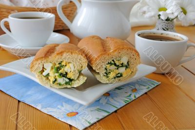 Baguette stuffed with spinach, onion and egg