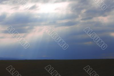 Dramatic sky and rays falling through the clouds