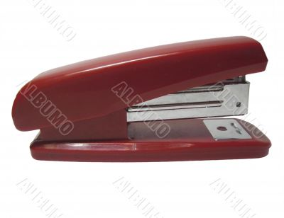 Red stapler isolated on the white background