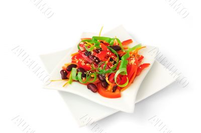 A salad of tomatoes, sweet peppers, red beans, carrots with sesa
