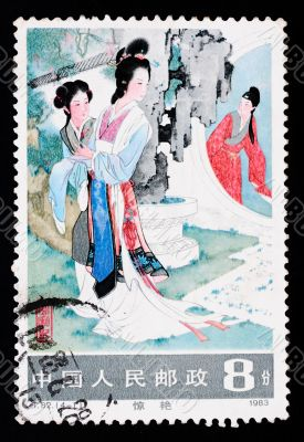 A stamp printed in China shows an ancient love story