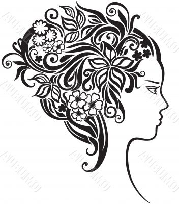 Girl with a beautiful flowers in her hair