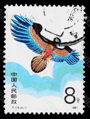 A stamp printed in China shows a kite of eagle figure  in the sky