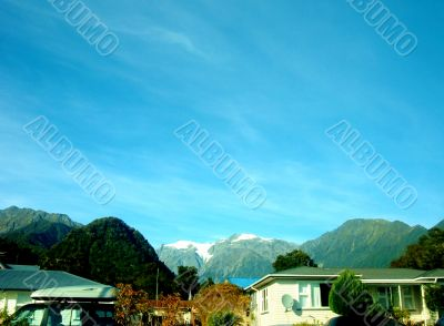 Blue Sky Above Mountains And Houses