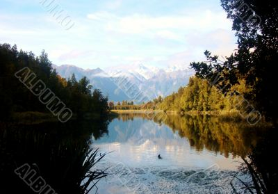 Ripples In Beautiful Lake With Mountains