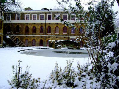 Georgian House Over Snowy Garden