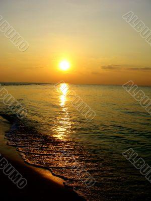 Sunset Over Breaking Surf