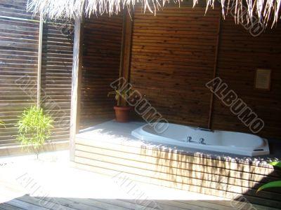 bath in wooden hut