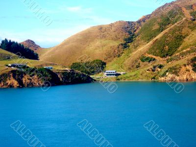 House On Edge Of Lake