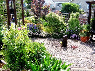 British Garden In Bloom With Water Feature