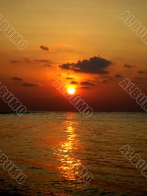 Sunset And Reflection In Sea