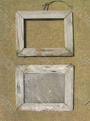 Two old wooden picture frame on the surface texture of burlap. T