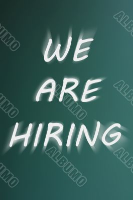 We are hiring - written on a green chalkboard background