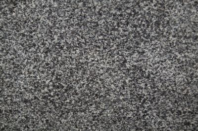 Closeup of dark grey granite texture