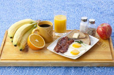 image of breakfast on wooden plank