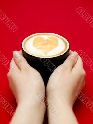reaching for coffee