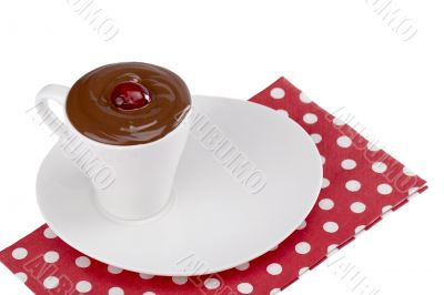 cup of chocolate on a plate with napkin