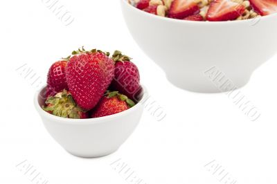 cropped bowl of cereals and strawberry
