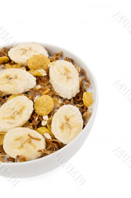 cropped image of cereal and banana in bowl
