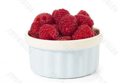 raspberries in a container