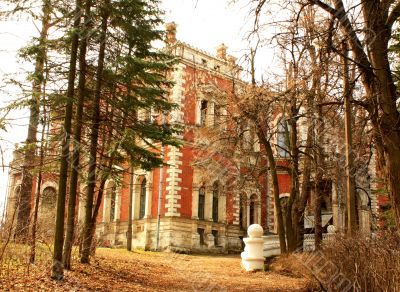 Abandoned old estate among the leafless trees