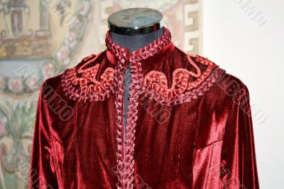 Embroidered red velvet jacket with braid