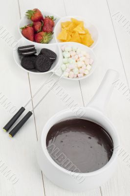 tempting desserts with melted chocolate bowl