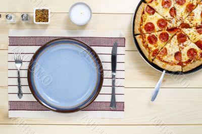 top view of table utensil  and pizza