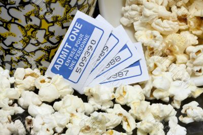 spilled popcorn with movie tickets