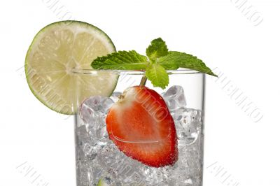 cropped image of a glass with ice cubes strawberry slice and lemon slice