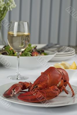 dinner table with lobster and wine