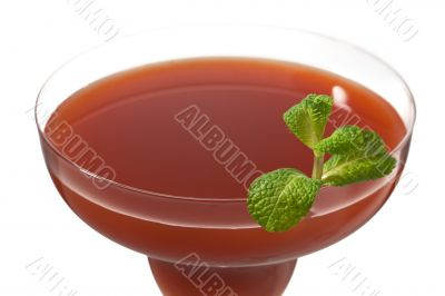 cropped image of strawberry juice in martini