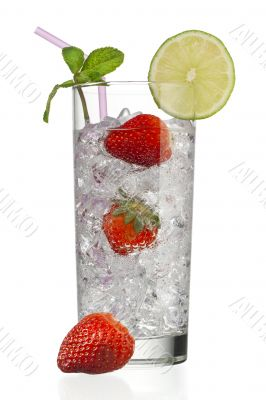 glass full of ice cubes with strawberries and decorated with lemon slice and peppermint