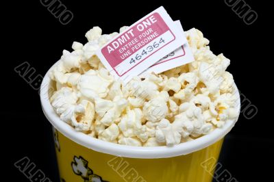 cropped image bucket of popcorn with movie ticket