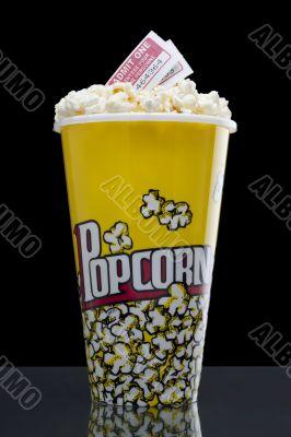 large popcorn bucket with movie passes