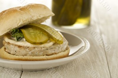 chicken hamburger with slices of pickle