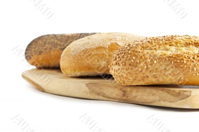 cropped image of breads on the wooden plank