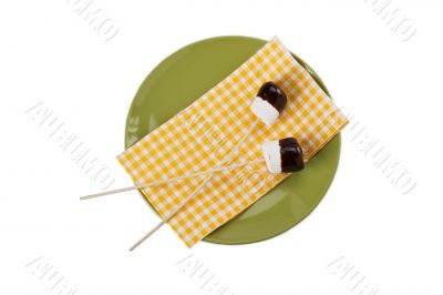 two marshmallow with  stick and chocolate