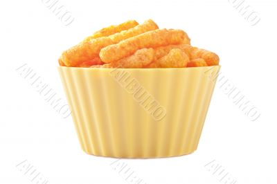 cheese puffs in yellow plastic bowl