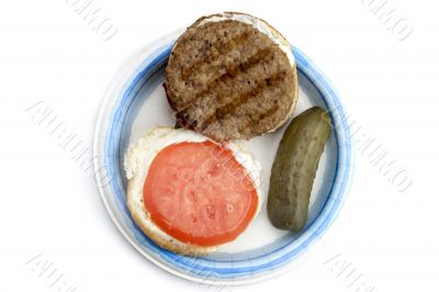 open burger with pickles on a plate