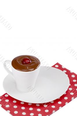 strawberry in cup of melted chocolate