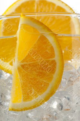 cropped image of orange slices with ice cubes