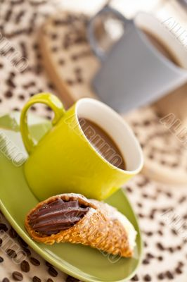coffee cup with pastry