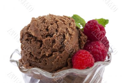closed up chocolate ice cream with raspberry and mint