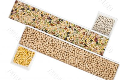 assorted beans in different rectangular boxes