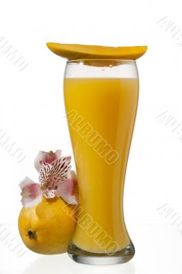 mango juice glass with slice of mango on top
