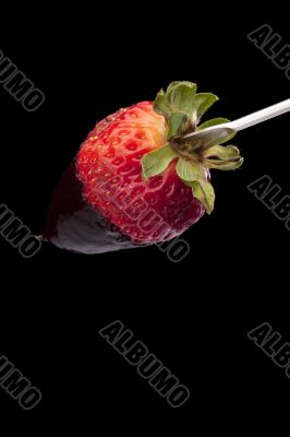 strawberry on the stick with chocolate dip