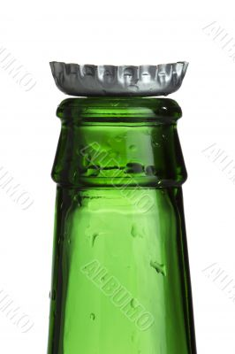 cropped image of a empty green bottle