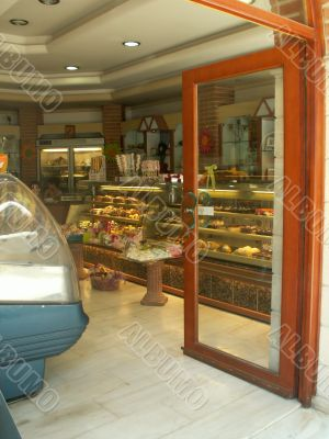 Open the door to the shop, and sweets