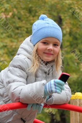 Small girl with cellular phone